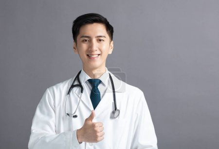 Portrait of male asian young doctor with thumbs up