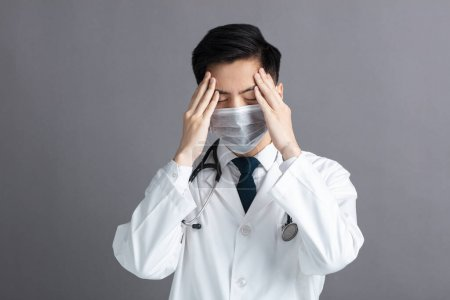 stress and tired young Doctor Wear Medical Mask