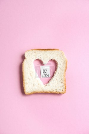 Toasted bread with heart shaped hole