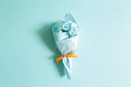 Blue flower bouquet on blue background