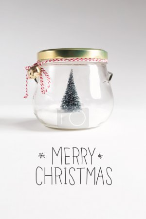 postcard with Christmas tree in jar and inscription