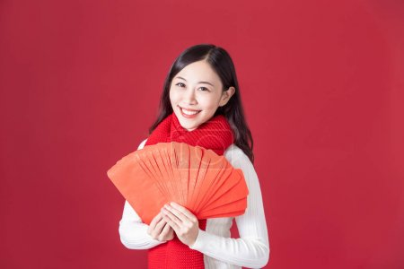 asian woman hold red envelopes