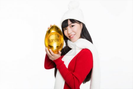 pretty girl holding a large gold inlot,a symbol of wealth,chines name is jinyuanbao.