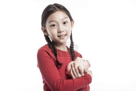 可爱的亚洲女孩省钱.