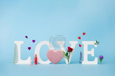 Spring flower holiday background with word Love. Happy Valentine Day concept